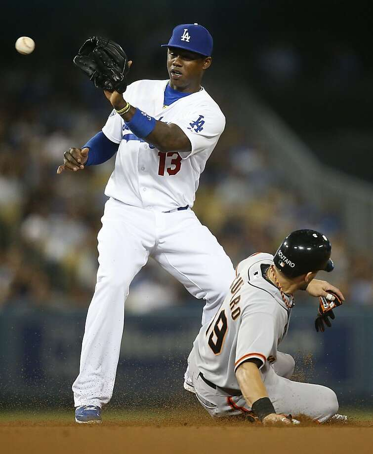 The throw to shortstop Hanley Ramirez was too late to get Marco Scutaro at second. Ramirez might move to third in 2013. Photo: Jae C. Hong, Associated Press