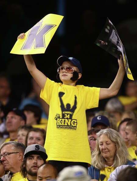 A young fan shows his support for Seattle Mariners pitcher Felix Hernandez during a game against the