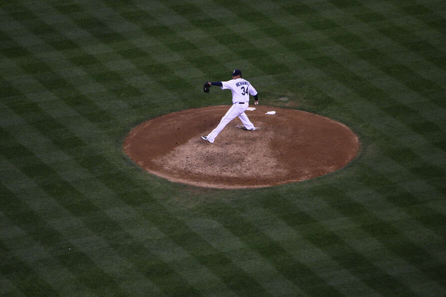Seattle Mariners pitcher Felix Hernandez throws against the Cleveland Indians on Tuesday, August 21,