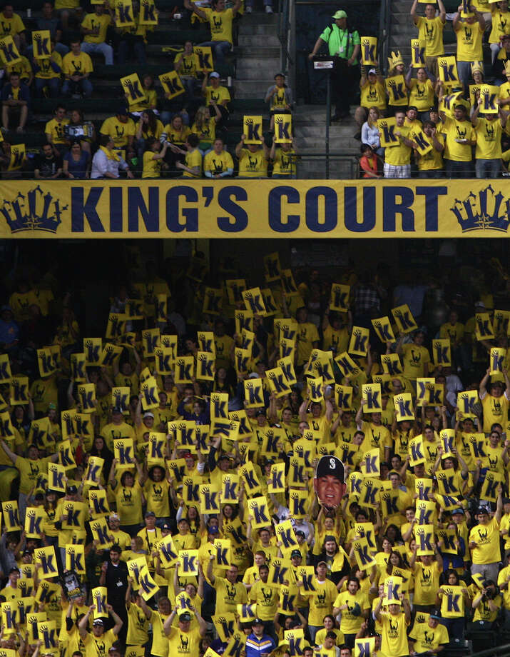 "Fans raise signs in the ""King's Court"" section of left field as Seattle Mariners pitcher Felix Hernandez strikes out a batter during a game against the Cleveland Indians on Tuesday, August 21, 2012 at Safeco Field in Seattle. The game was the first start by Hernandez after throwing a perfect game in his previous appearance on the mound for the Mariners. Photo: JOSHUA TRUJILLO / SEATTLEPI.COM"
