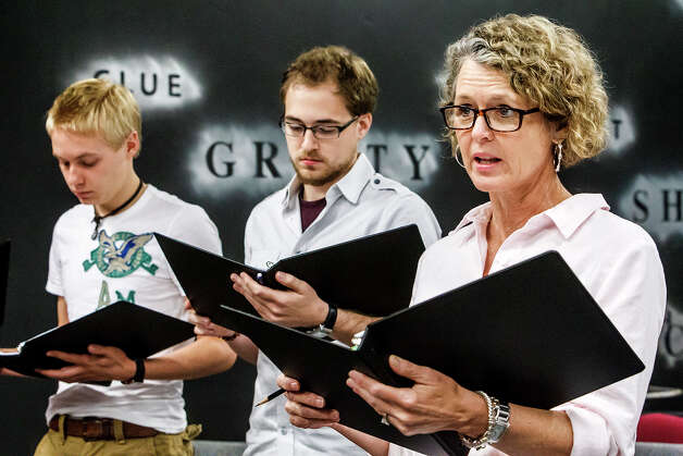 "Catherine Babbitt (right) reads her lines with Mark McCarver (center) and Brennan Loy as a group of San Antonio actors rehearsed for ""8."" Photo: Marvin Pfeiffer, San Antonio Express-News / Express-News 2012"