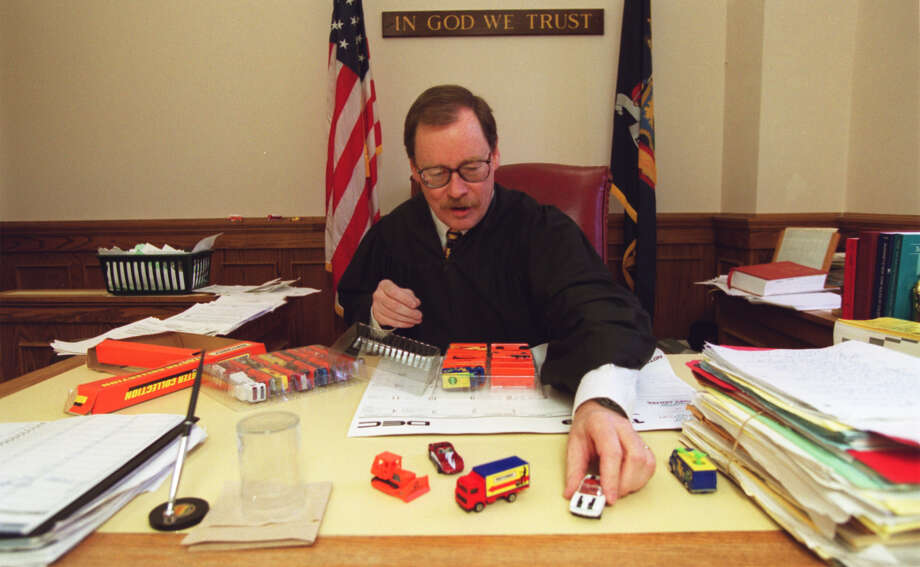 Former Family Court Judge Bryan Hedges puts out new model cars for children who come into his court in 1999. He says all kids get to take home a car or truck. (C. W. McKeen / Courtesy of The Syracuse Post-Standard)