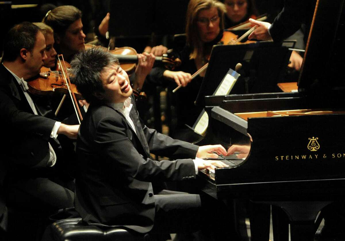 Pianist Lang Lang performs with the San Antonio Symphony Orchestra and conductor Sebastian Lang-Lessing at the Majestic Theatre on Wednesday, Jan. 12, 2011. BILLY CALZADA / gcalzada@express-news.net