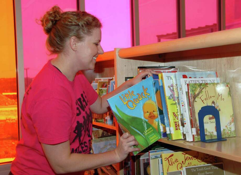 Indian Springs Elementary Librarian Andrea Mikeska loads her bookshelves in preparation for the opening day of school on Monday at Comal ISDÕs newest campus. Photo: Courtesy Photo