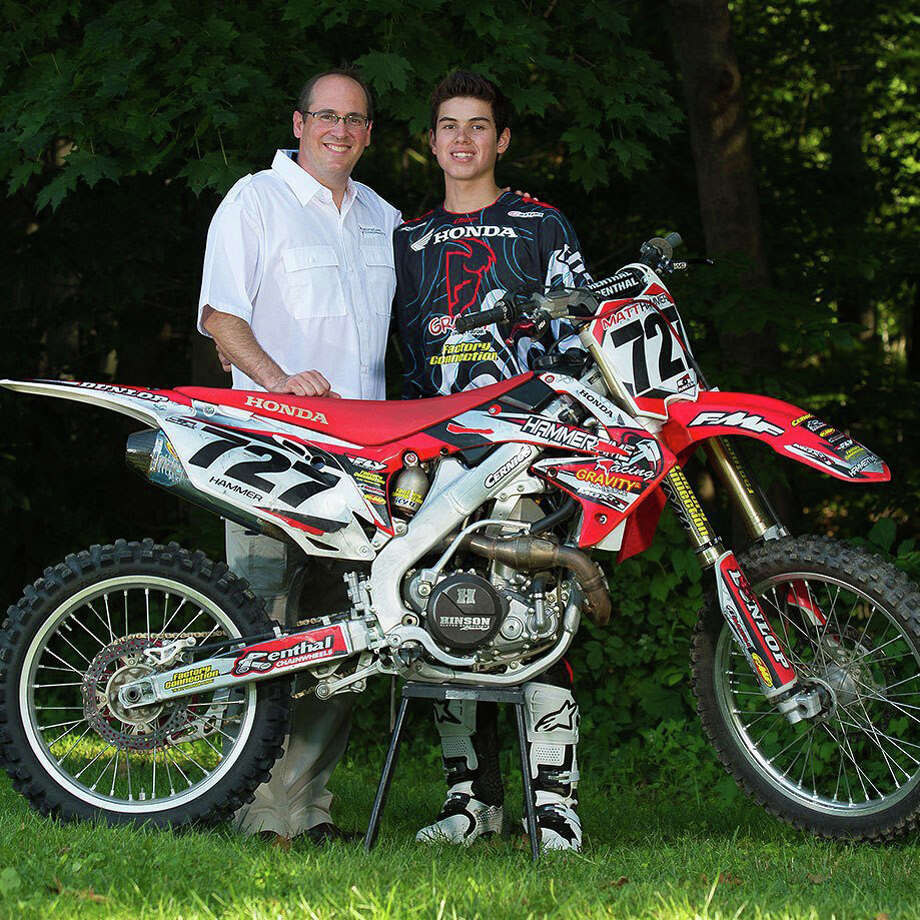 Dr. Christopher Mascetta, founder and owner of Ridgefield Chiropractic, left, teamed up with motocross racer Matthew Hammer for Hammerís Red Bull AMA Amateur National Motocross Championships race. Photo: Contributed Photo