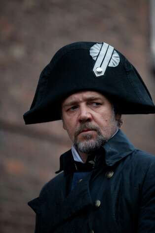 "OscarAE winner RUSSELL CROWE as Javert in ""Les Misérables"", the motion-picture adaptation of the beloved global stage sensation seen by more than 60 million people in 42 countries and in 21 languages around the globe and still breaking box-office records everywhere in its 27th year.  Helmed by ""The King's Speech's"" Academy AwardAE-winning director, Tom Hooper, the Working Title/Cameron Mackintosh production stars Hugh Jackman, Crowe, Anne Hathaway, Amanda Seyfried, Eddie Redmayne, Aaron Tveit, Samantha Barks, with Helena Bonham Carter and Sacha Baron Cohen. Photo: Photo Credit: Laurie Sparham"
