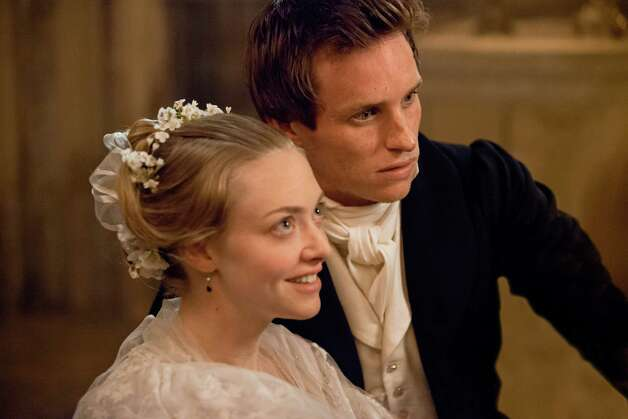 "AMANDA SEYFRIED as Cosette and EDDIE REDMAYNE as Marius in ""Les Misérables"", the motion-picture adaptation of the beloved global stage sensation seen by more than 60 million people in 42 countries and in 21 languages around the globe and still breaking box-office records everywhere in its 27th year.  Helmed by ""The King's Speech's"" Academy AwardAE-winning director, Tom Hooper, the Working Title/Cameron Mackintosh production stars Hugh Jackman, OscarAE winner Russell Crowe, Anne Hathaway, Seyfried, Redmayne, Aaron Tveit, Samantha Barks, with Helena Bonham Carter and Sacha Baron Cohen. Photo: Photo Credit: Laurie Sparham"