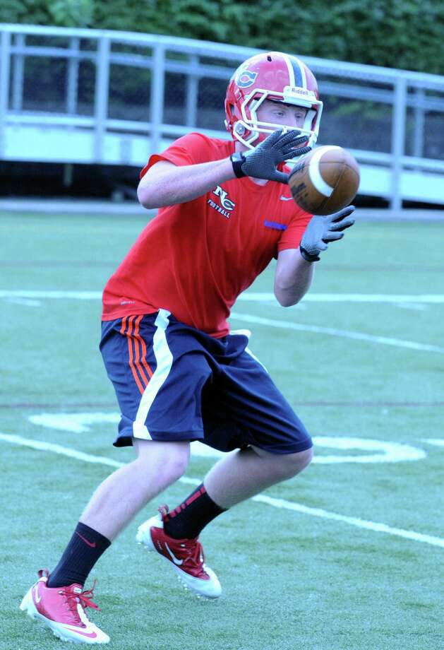 Andrew Read in action during the Rams football practice at New Canaan High School in New Canaan, Conn., August 20, 2012. Photo: Keelin Daly / Stamford Advocate