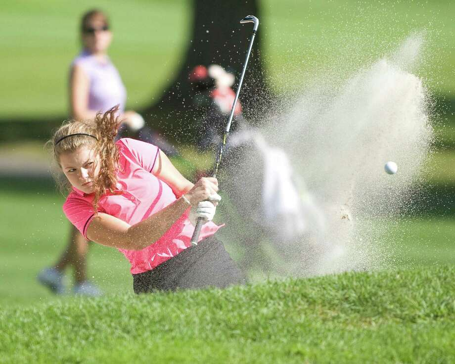 Sam Steichen, 17, of Danbury blasts out of a sand trap during play in the Fran McCarthy Junior Golf Tournament Tuesday at Richter Park Golf Course in Danbury. Photo: Barry Horn / The News-Times Freelance