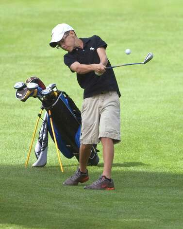 Alec Moore, 14, of Danbury hits a fairway iron during play in the Fran McCarthy Junior Golf Tournament Tuesday at Richter Park Golf Course in Danbury. Photo: Barry Horn / The News-Times Freelance