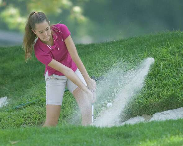 Katelyn Mooney, 14, of Danbury explodes out of a sand trap during play in the Fran McCarthy Junior Golf Tournament Tuesday at Richter Park Golf Course in Danbury. Photo: Barry Horn / The News-Times Freelance