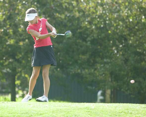 Lauren Gherna, 11, of Danbury hits off the 10th tee during play in the Fran McCarthy Junior Golf Tournament Tuesday at Richter Park Golf Course in Danbury. Photo: Barry Horn