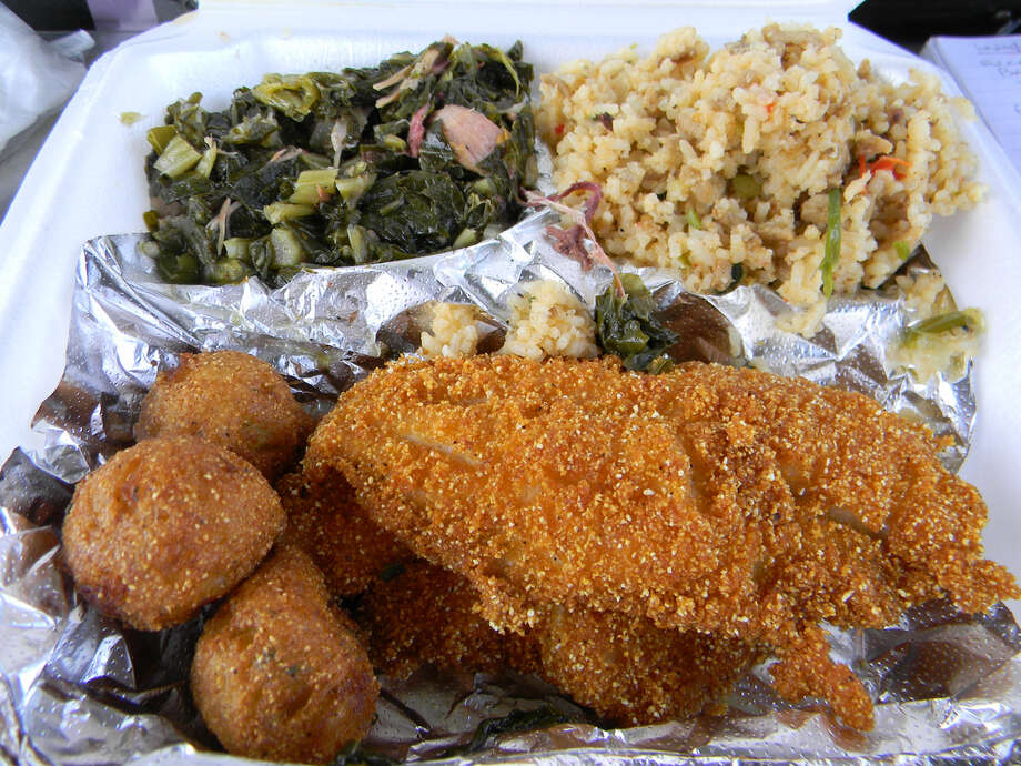 Among the specialties at Soul Cat Cuisine are fried catfish, dirty rice, greens and pecan-covered bread pudding. Photo: Paul Galvani