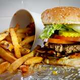 """A regular burger with toppings  """"All the Way"""" and french fries at Five Guys in Burlingame."""