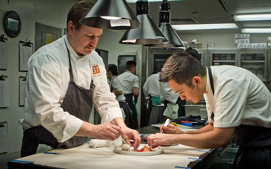 Chef Ron Siegel (left), with sous chef Andre Villahermosa at Parallel 37, says he and Michael Mina want the same thing - the best restaurant. Photo: John Storey