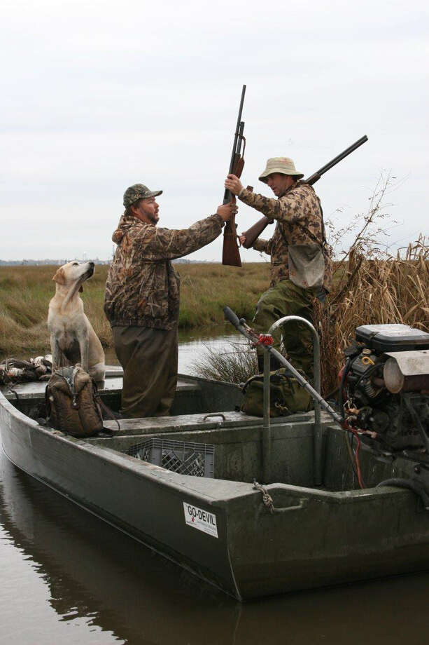 A 12-gauge pump shotgun is rugged and reliable for duck hunting in coastal marshes. Photo: Houston Chronicle, Joe Doggett