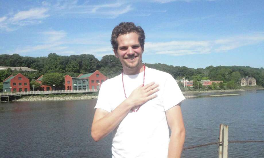 Charlie Kniffin downtown on the banks of the Saugatuck River Photo: Nicoletta Richardson / Westport News contributed