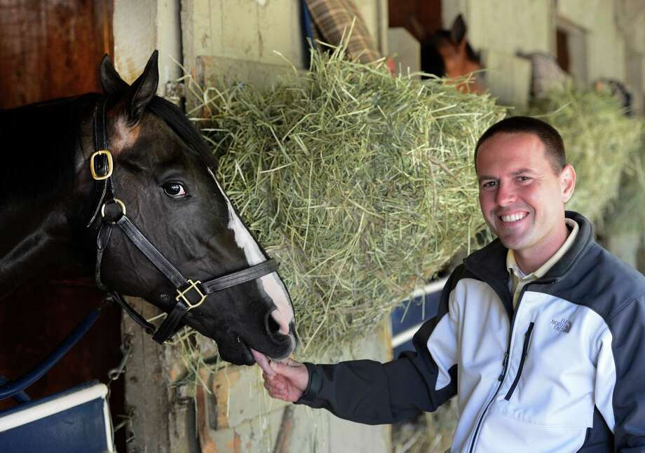 Trainer Chad Brown with Street Life at Brown's barn on the Oklahoma Training Center in Saratoga Springs, N.Y. Aug 22, 2012. An injury in the Travers led Brown to retire him. (Skip Dickstein/Times Union archive) Photo: Skip Dickstein
