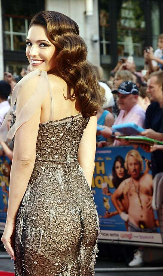 "The bottom line: There's no disputing British actress Kelly Brook's ample assets, but is the crack on the dress really necessary? Brook attended the premiere of her latest film, ""Keith Lemon: The Film,"" in London. Photo: Max Nash, AFP/Getty Images"