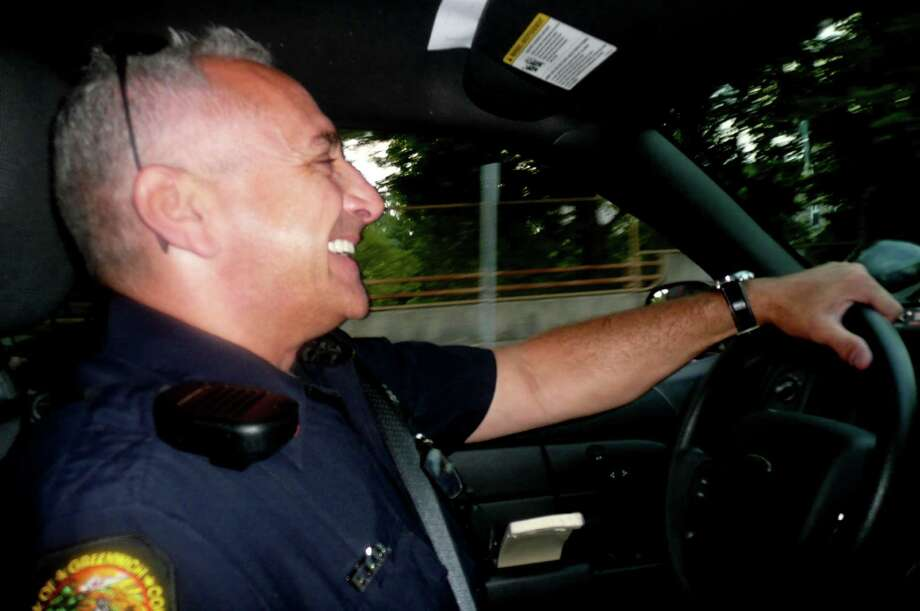 """The Greenwich Police Department offers a ride-along with a Greenwich Police Officer as part of its upcoming Citizen's Police Academy. To get a taste of what that might be like, Greenwich Citizen reporter Anne Semmes rode along recently with Police Officer Bob Ferretti. """"The best part about the Citizen's Police Academy,"""" Ferretti says, """"is that it makes all the graduates another set of eyes or ears for the police department."""" Photo: Anne W. Semmes"""
