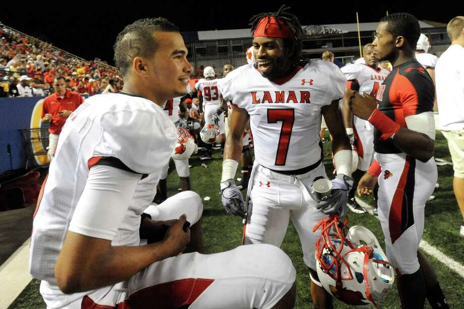 Lamar quarterback Andre Bevil, left, and defensive back Steven Murray-Sesay keep each other energized in the first half against McNeese State in Lake Charles La. on Saturday, September 4, 2010  Valentino Mauricio/The Enterprise Photo: Valentino Mauricio / Beaumont