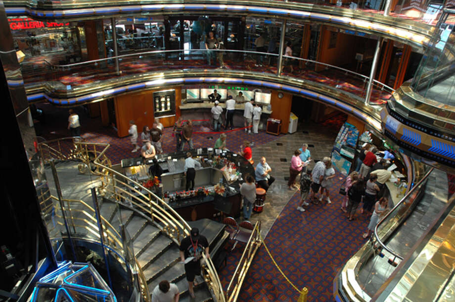 The floor of a seven-deck atrium on Carnival Cruise Lines' Ecstasy includes a bar and serves as a venue for classical music during afternoons. HARRY SHATTUCK: CHRONICLE Photo: Harry Shattuck, . / HOUSTON CHRONICLE