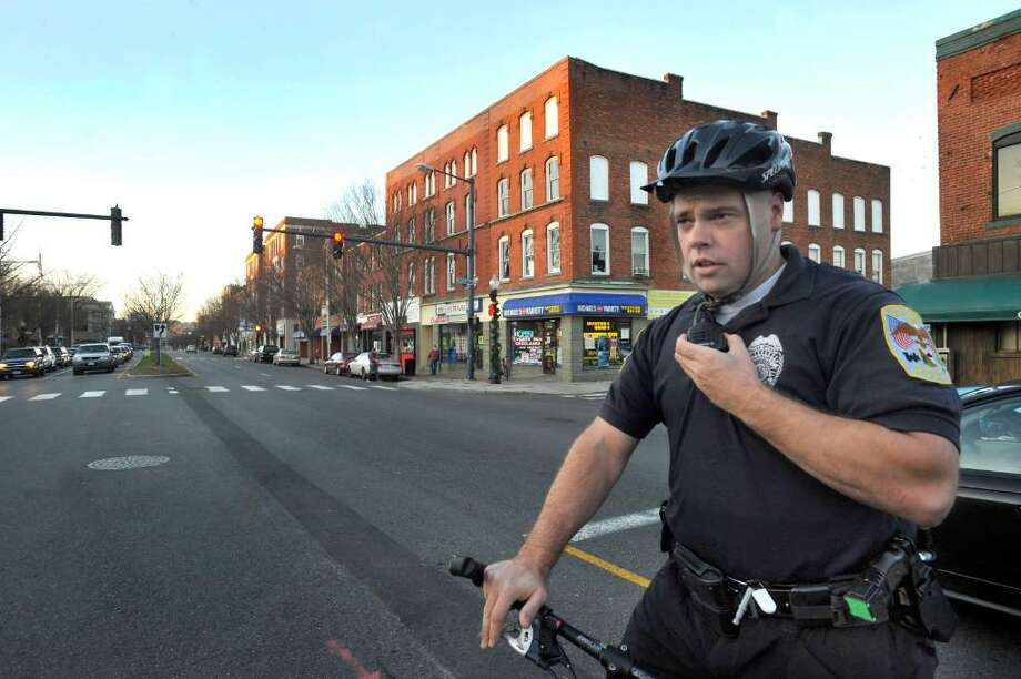 Officer Sonny Usher, CityCenter Liaison Officer with the Danbury Police, on patrol in Downtown Danbury on Friday,Nov.20,2009. Photo: Michael Duffy / The News-Times
