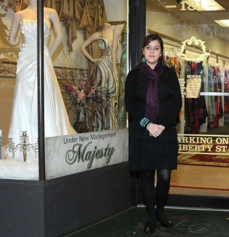 Morgana Robacher, owner of Majesty Bridal, stands in the entrance of her bridal salon, at 181 Main St., Danbury, CT, on Thursday, Nov. 19, 2009. Photo: Jay Weir / The News-Times