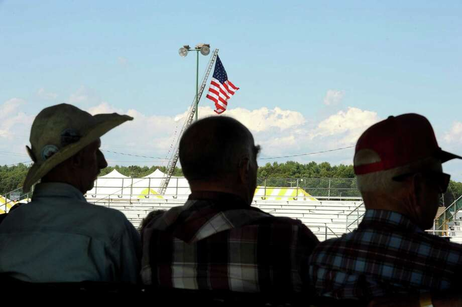 Spectators sit in the shade as they watch the tractor pull events during the Washington County Fair in Greenwich, NY Wednesday Aug. 22, 2012. (Michael P. Farrell/Times Union) Photo: Michael P. Farrell