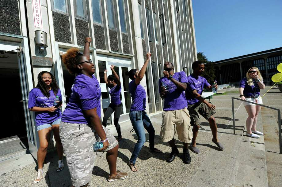 Resident assistants dance to the music at Eastman Tower on freshmen moving-in day on Wednesday, Aug. 22, 2012, University at Albany in Albany, N.Y. (Cindy Schultz / Times Union) Photo: Cindy Schultz / 00018846A
