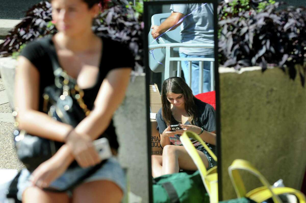 Freshman Kristin Giordano, 18, of Nassau County, center, waits her turn to move into Eastman Tower on State Quad on moving-in day on Wednesday, Aug. 22, 2012, University at Albany in Albany, N.Y. (Cindy Schultz / Times Union)