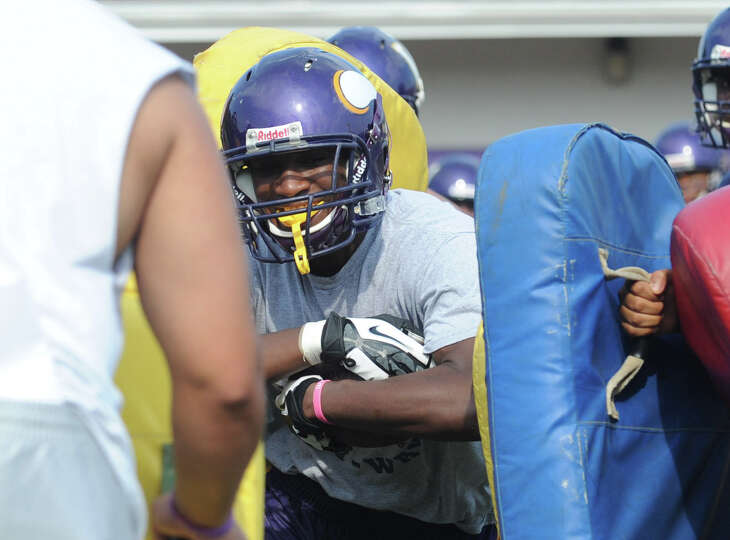 Davell Cotterell carries during football practice at Westhill High School in Stamford, Conn., August