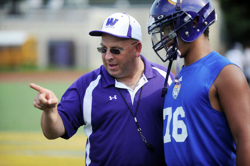 Coach Frank Marcucio speaks with Deondrick Lavine during football practice at Westhill High School i