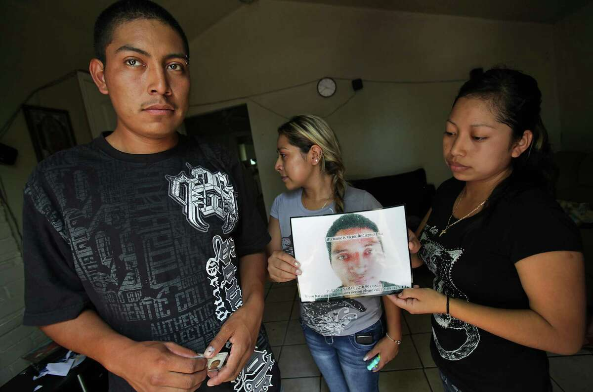 Nereo Diaz, 23 (from left), Elda Diaz, 24, and Luci Diaz, 21, display a photo of sibling Victor Diaz. They spent a week searching for him after the worker vanished.