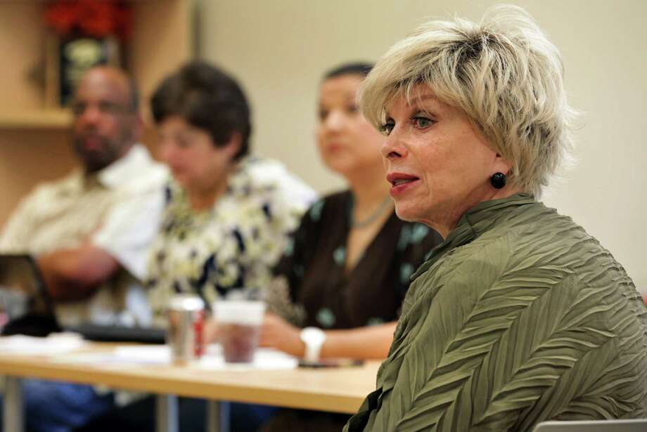 "Consultant Tracy Goss prods SAISD trustees for their thoughts during a ""self-evaluation"" session with the board. Photo: BOB OWEN, San Antonio Express-News / © 2012 San Antonio Express-News"