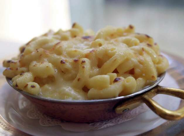 The Creamy Macaroni and Cheese side dish at Bohanan's lives up to its billing. A combination of rich cheeses melts into gooey greatness with the pasta, all served in a small skillet that is passed under heat to slightly brown the top. Photo: Julysa Sosa, San Antonio Express-News / © 2012 San Antonio Express-News