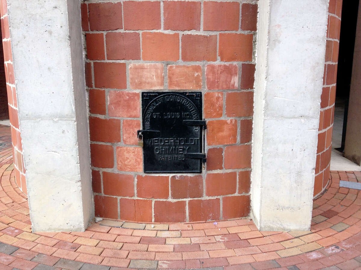 This is the door - locked from the outside - in the base of the smokestack. Blood on the inside of the door indicates the trapped man used his hands in a desperate bid to get out.