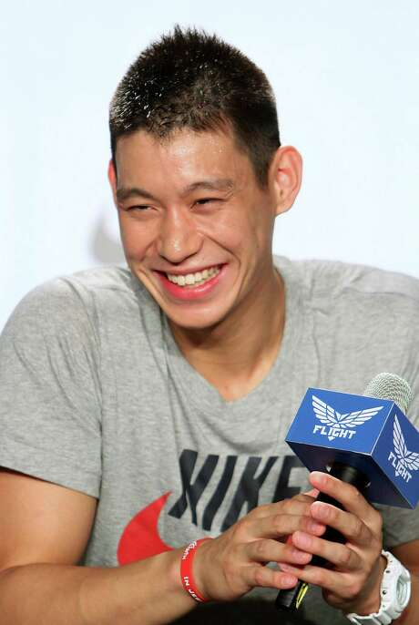 NBA basketball player Jeremy Lin of the Houston Rockets smiles during a media event in Taipei, Taiwan, Sunday, Aug. 5, 2012. Lin is one of the few Asian Americans in the NBA history, and the first American of Taiwanese descent to play in the league. (AP Photo/Chiang Ying-ying) Photo: Chiang Ying-ying / AP