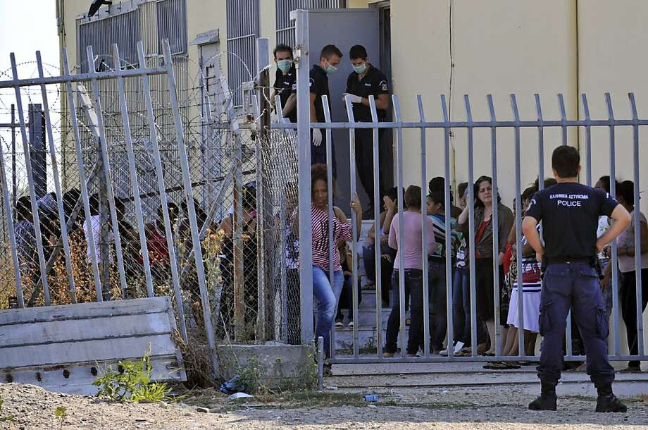 Illegal immigrants are held at a detention center in Filakio, Greece, near the border with Turkey on Aug. 9. Most people making the clandestine journey to the EU pass through Greece. Photo: Nikolas Giakoumidis, Associated Press