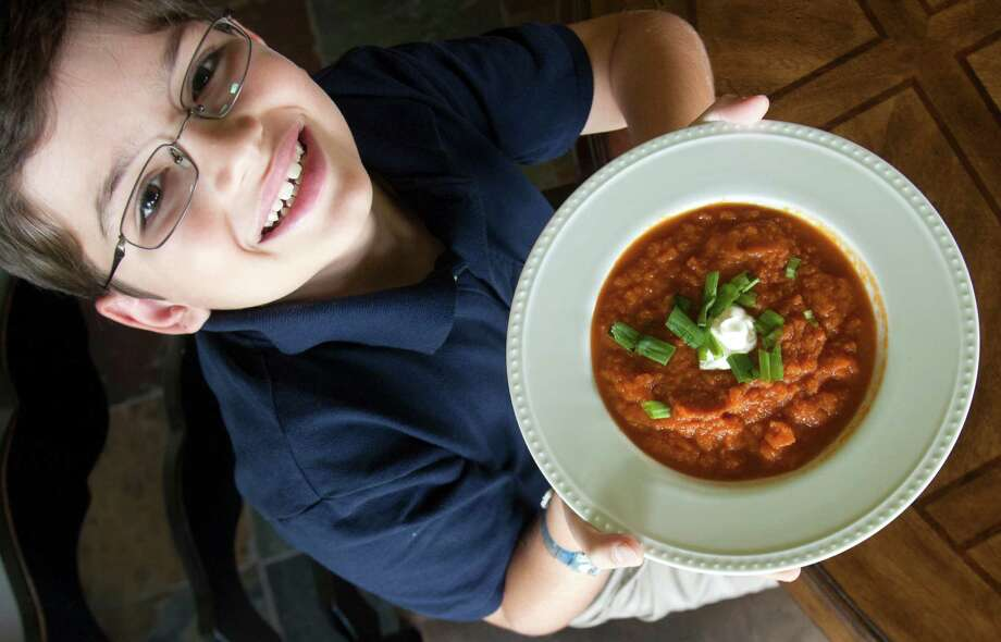 Michael Lakind, 9, of Sugar Land prepares his recipe for bunny bisque soup that he entered in the Epicurious Healthy Lunchtime Challenge. Michael is one of 54 kids across the nation who won the contest and lunch at the White House. His winning recipe is Super Secret Service Salad. Photo: J. Patric Schneider / © 2012 Houston Chronicle