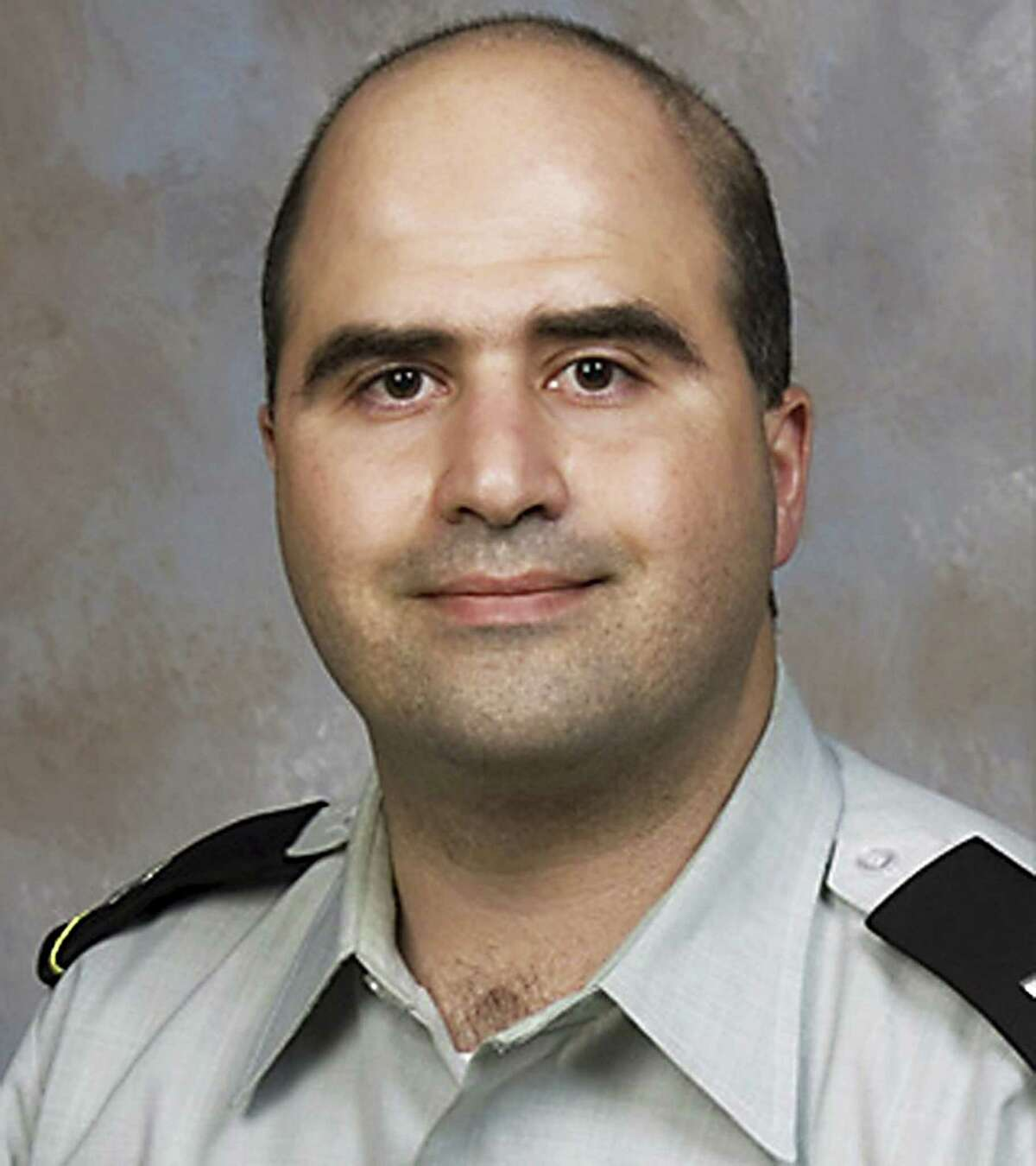 (FILES)This undated handout photo provided by the US Uniformed Services University of the Health Sciences shows US Army Major Nidal Hasan. A US military court on August 15, 2012 delayed the trial of an officer accused of killing 13 people in a shooting spree on his base while judges decide if he can be forcibly shaved. Major Nidal Hasan, a former army psychiatrist, is accused of carrying out the November 2009 shooting rampage at Fort Hood, an attack that raised fears of homegrown extremism and Al-Qaeda recruitment within the armed forces. An American of Palestinian heritage, Hasan tried to plead guilty on 13 counts of premeditated murder, but Colonel Gregory Gross, who is hearing the case, said military law does not allow guilty pleas in death penalty trials. Gross entered a not guilty plea instead. AFP PHOTO/HANDOUT == GETTY OUT = RESTRICTED TO EDITORIAL USE - MANDATORY CREDIT