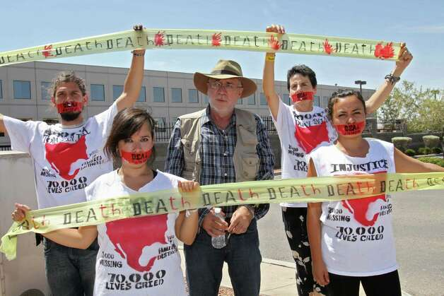 "Mexican peace activist Javier Sicilia (center) and supporters from the ""Caravan for Peace"" protest outside City Hall in El Paso this week. They'll hold a vigil here Friday night. Photo: JESUS ALCAZAR, AFP/Getty Images / AFP"