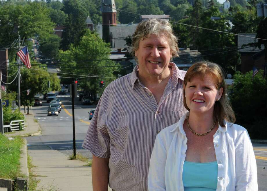 "Writer/director Tennyson Bardwell and his wife, Mary-Beth Taylor stand on a sidewalk along Rt. 50 Wednesday, Aug. 22, 2012 in Ballston Spa, N.Y. The couple are planning on filming the movie ""Bully Pulpit"" about bullying in a small town high school in Saratoga County. (Lori Van Buren / Times Union) Photo: Lori Van Buren"