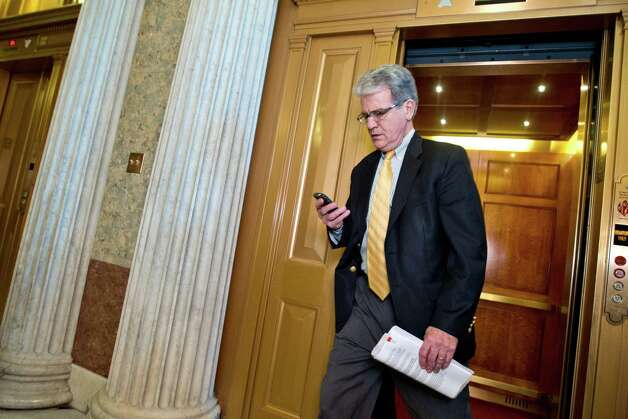 The nation would be better served if Sen. Tom Coburn, R-Okla., were setting fiscal policy for the Republican Party and radical voices were ignored. Photo: J. Scott Applewhite, Associated Press / AP