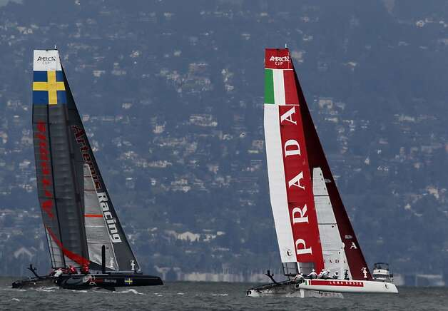 Sweden's Artemis Red team races against the Luna Rossa Piranha boat from Italy in the qualifying round for the America's Cup World Series of yacht racing in San Francisco, Calif. on Wednesday, Aug. 22, 2012. Photo: Paul Chinn, The Chronicle