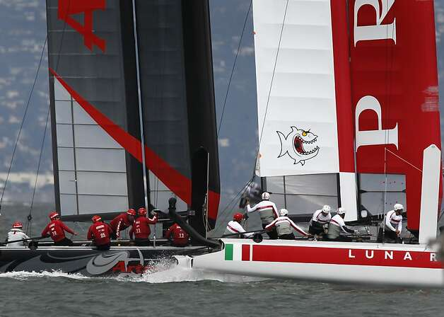 Crews from Sweden's Artemis Red team (left) and the Luna Rossa Piranha team from Italy battle for position at the starting line of a race in the qualifying round of the America's Cup World Series of yacht racing in San Francisco, Calif. on Wednesday, Aug. 22, 2012. Photo: Paul Chinn, The Chronicle