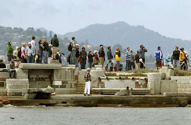 Spectators line the edge of the Bay, near the Golden Gate Yacht Club,  during the match racing qualifier at the 2012 America's Cup World Series, in San Francisco, Calif., on Wednesday August 23, 2012. Photo: Michael Macor, The Chronicle