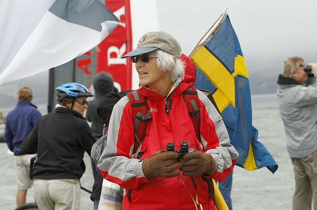 Alice Philipson, of San Francisco, who is cheering for Team Sweden joins spectators at the edge of the Bay to watch the match racing qualifier at the 2012 America's Cup World Series, in San Francisco, Calif., on Wednesday August 23, 2012. Photo: Michael Macor, The Chronicle