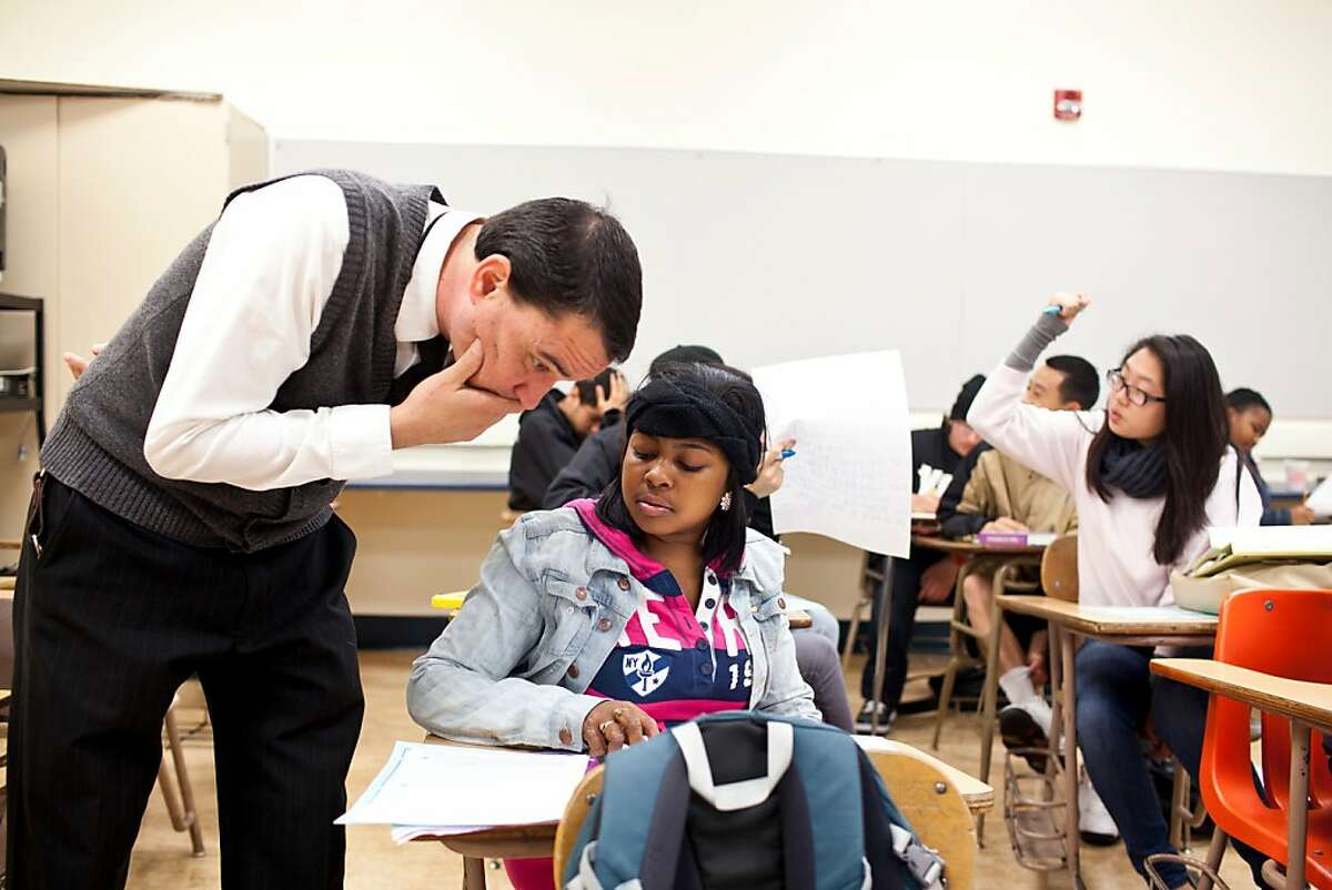 Lalonie Williams, 15, gets advice from 10th grade american literature teacher Chris Harris at Raoul Wallenberg Traditional High School in San Francisco, Calif., Wednesday, August 22, 2012.