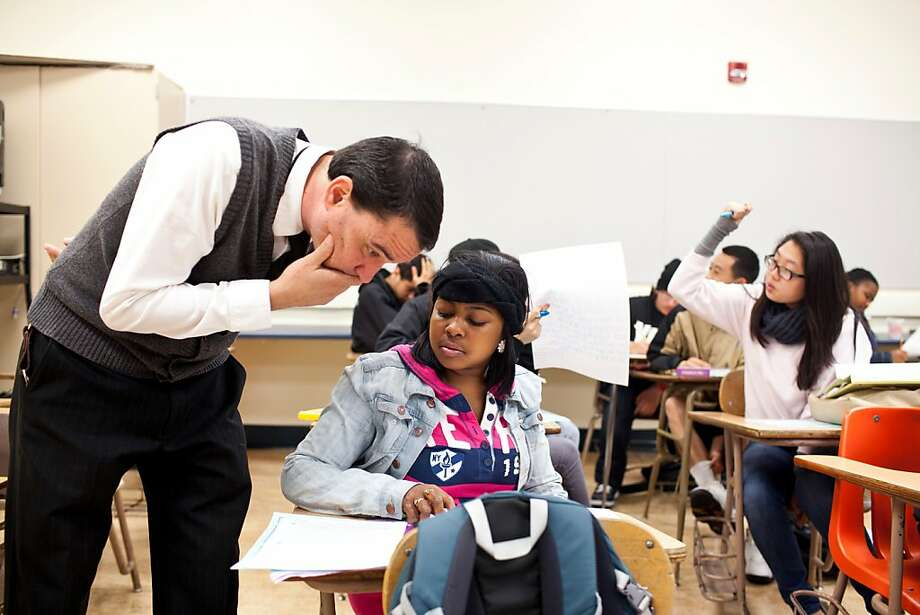 Lalonie Williams, 15, gets advice from 10th-grade American literature teacher Chris Harris at Wallenberg High in S.F. Photo: Jason Henry, Special To The Chronicle